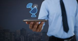 Hand holding tablet with wifi signal icon royalty free stock photo