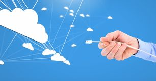 Hand holding wire connection with clouds. Digital composite of Hand holding wire connection with clouds Stock Photos