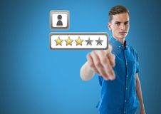 Hand pointing at star review ratings. Digital composite of Hand pointing at star review ratings stock image