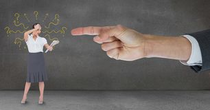 Hand pointing at surprised business woman against grey background with question marks Stock Image