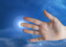 Hand touching the air with glow Stock Images