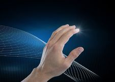 Hand touching the air with glow. Digital composite of Hand touching the air with glow Royalty Free Stock Photo