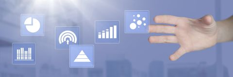Hand touching business chart statistic icons. Digital composite of Hand touching business chart statistic icons Royalty Free Stock Photo