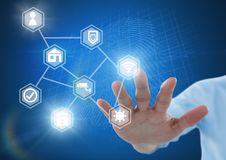 Hand touching icons interface of internet of things. Digital composite of Hand touching icons interface of internet of things Royalty Free Stock Images