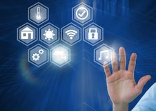 Hand touching icons interface of internet of things. Digital composite of Hand touching icons interface of internet of things Royalty Free Stock Photography