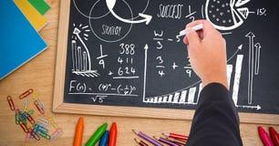 Hand writing math strategy success text on blackboard. Digital composite of Hand writing math strategy success text on blackboard royalty free stock photo