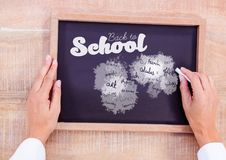 Hand writing school subjects and back to school text on blackboard Stock Photography