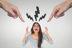 Hands pointing at angry woman against white background with lightning icons Royalty Free Stock Image