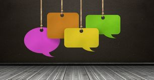 Hanging paper speech bubbles and blackboard background. Digital composite of Hanging paper speech bubbles and blackboard background Royalty Free Stock Photos