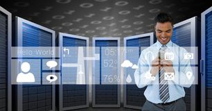 Happy business man holding a phone and graphics in server room Royalty Free Stock Photography