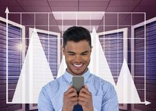 Happy business man holding a phone and graphics in server room. Digital composite of Happy business man holding a phone and graphics in server room Royalty Free Stock Photography