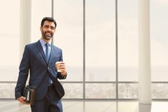 Happy business man standing against building background Stock Photography