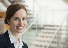 Happy business woman standing against office background Royalty Free Stock Photos