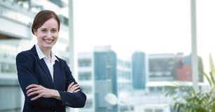 Happy business woman standing against office background Stock Photography
