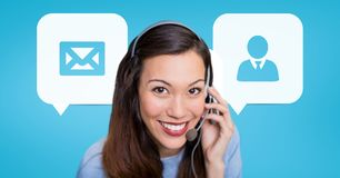 Happy customer care assistant woman against customer care background Royalty Free Stock Images