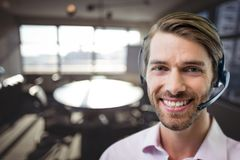 Happy customer care representative man against office background Royalty Free Stock Images