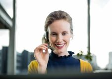 Happy customer care representative woman against city background Stock Images
