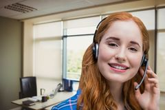 Happy customer care representative woman against office background Stock Images