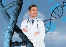 Happy doctor man standing with 3D DNA strands Royalty Free Stock Photos
