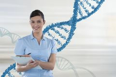 Happy doctor woman holding a folder with 3D DNA strands. Digital composite of Happy doctor woman holding a folder with 3D DNA strands Royalty Free Stock Photography