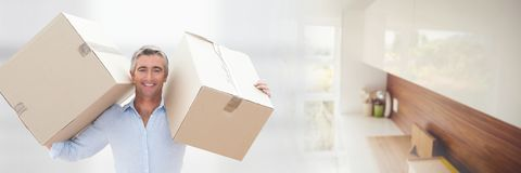 Happy man moving boxes in his new house Stock Photography