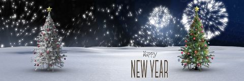 Happy new year text and Christmas trees in winter landscape with fireworks. Digital composite of Happy new year text and Christmas trees in winter landscape with Stock Image