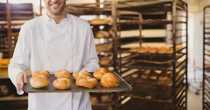 Happy small business owner man holding bread royalty free stock images