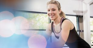 Happy woman exercising in gym Stock Photos