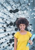 Happy young student woman holding a folder against blue splattered background. Digital composite of Happy young student woman holding a folder against blue Stock Photos