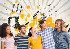 Happy young students standing against grey, yellow and black splattered background. Digital composite of Happy young students standing against grey, yellow and Stock Photo