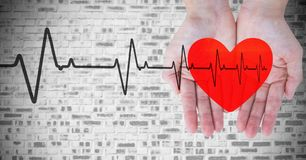 Heart beat over hands holding heart. Digital composite of Heart beat over hands holding heart Royalty Free Stock Photos