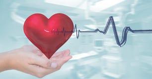 Heart beat over hands holding heart. Digital composite of Heart beat over hands holding heart stock image