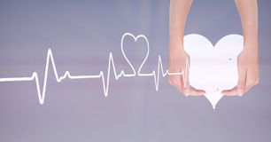 Heart beat over hands holding heart. Digital composite of Heart beat over hands holding heart royalty free stock photography