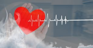 Heart beat over hands holding heart. Digital composite of Heart beat over hands holding heart stock photos