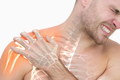 Digital composite of highlighted shoulder pain of man. Against white background stock image