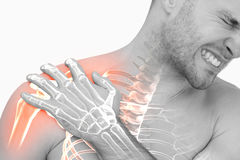 Digital composite of highlighted shoulder pain of man. Against white background royalty free stock photo