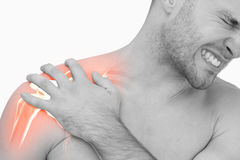 Digital composite of highlighted shoulder pain of man Stock Photo