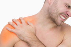 Digital composite of highlighted shoulder pain of man Stock Image