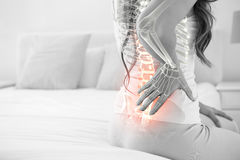 Digital composite of highlighted spine of woman with back pain Royalty Free Stock Photography