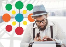 Hipster on typewriter with colorful mind map Royalty Free Stock Photography
