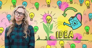 Hipster woman with colorful idea light bulbs graphics. Digital composite of Hipster woman with colorful idea light bulbs graphics Royalty Free Stock Photo