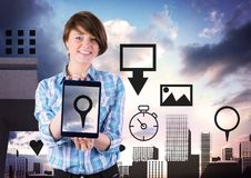 Holding tablet and City with icons Stock Photography