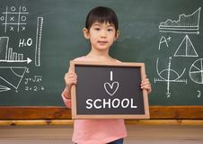 I love school text and little girl with blackboard. Digital composite of I love school text and little girl with blackboard Stock Photography