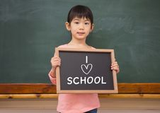 I love school text and little girl with blackboard. Digital composite of I love school text and little girl with blackboard Stock Images