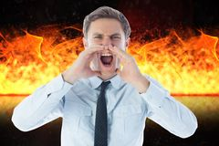 Digital composite image of angry businessman screaming against fire. Digital composite of Digital composite image of angry businessman screaming against fire Stock Image