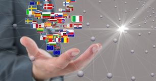 Digital composite image of business hand with flags and connecting dots. Digital composite of Digital composite image of business hand with flags and connecting royalty free stock photography