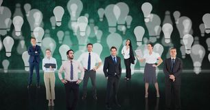 Digital composite image of business people over light bulb background royalty free stock images