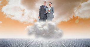 Digital composite image of business people using tablet computer on cloud in sky Stock Image