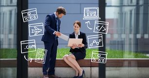 Digital composite image of business people using technologies by icons Stock Photography