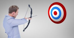 Digital composite image of businessman aiming at the target board. Against grey background Stock Photos